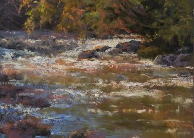 plein air soft pastel painting of a mountain river by Sharon Bamber