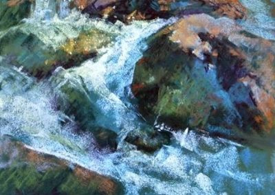 plein air soft pastel painting of a mountain stream and rocks by Sharon Bamber