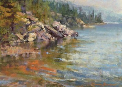 plein air soft pastel painting of a rocky lakeshore by Sharon Bamber