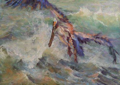 soft pastel painting of a pelican flying over waves by Sharon Bamber