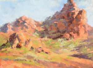 plein air soft pastel painting of red rocky outcrops by Sharon Bamber