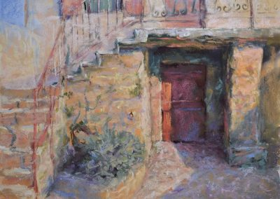 The Old Forge by Sharon Bamber plein air soft pastel painting of an old stone building in France