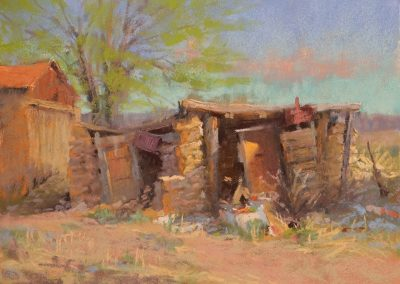 Harmonica Blues by Sharon Bamber plein air soft pastel painting of crumbling adobe building