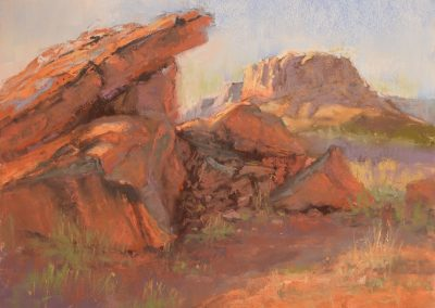 Overshadowed by Sharon Bamber plein air soft pastel painting of desert rocks and mesa